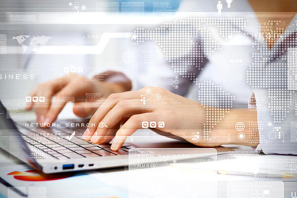 Business person working on computer against technology background